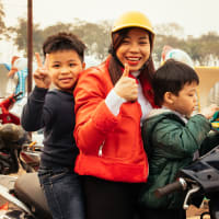 Family day at Hanoi's West Lake with boat ride